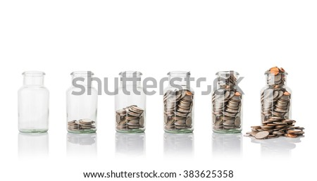 Glass jars with coins, savings concept - stock photo