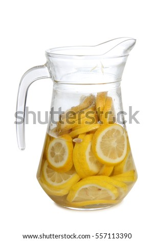 Glass jars with lemon juice on a white background