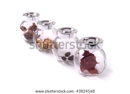 glass jars with nature findings. - stock photo