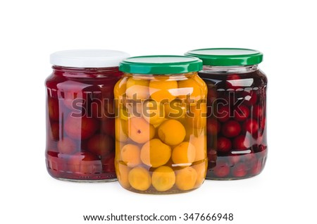 Glass jars with preserved cherries, plums and apricots isolated on white background - stock photo