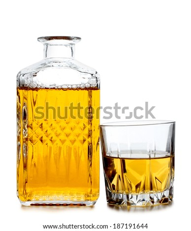 Glass jars with whiskey and ice on white background - stock photo