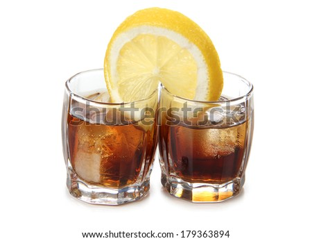 Glass jars with whiskey on a white background