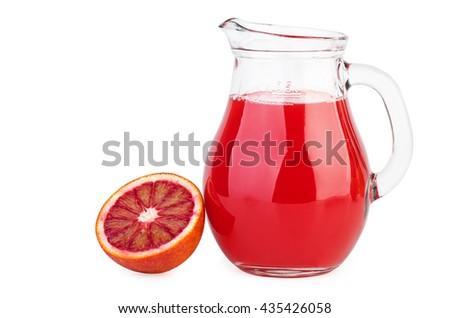 Glass jug with bloody orange juice isolated on white background - stock photo