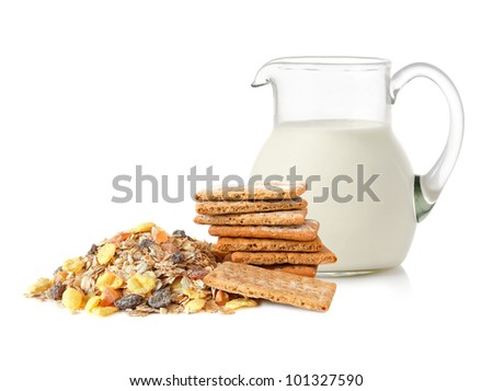 Glass jug with milk, stack of cracker slices, and and muesli for balance diet on white background