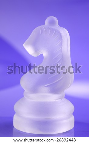 Glass knight in violet chess board background - stock photo