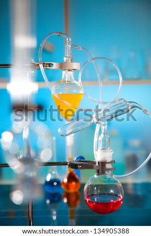 glass laboratory apparatus with liquid samples - stock photo