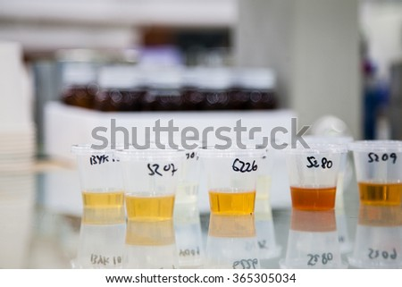 Glass laboratory chemical test tubes with colorful liquid. Selective focus effect with blur background - stock photo