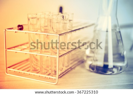 Glass laboratory chemical test tubes with liquid. Selective focus effect,science background - stock photo
