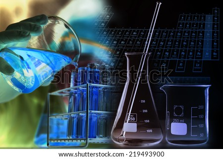 Glass laboratory chemical test tubes with yellow liquid.Man wear