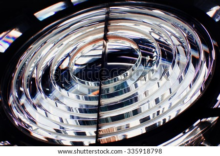 Glass lens of the lighthouse closeup - stock photo