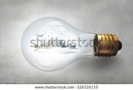 Glass light bulb with green life concept inside - stock photo