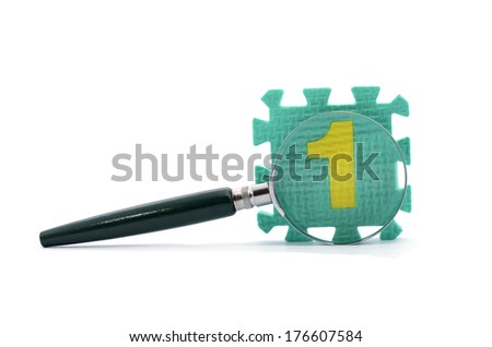 Glass magnifier with block number 1 - stock photo
