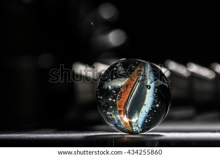 Glass marble orange and blue - stock photo