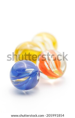 Glass marbles on White background - stock photo