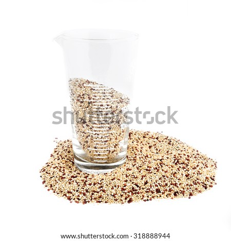 Glass measuring Cup with red and white quinoa - stock photo