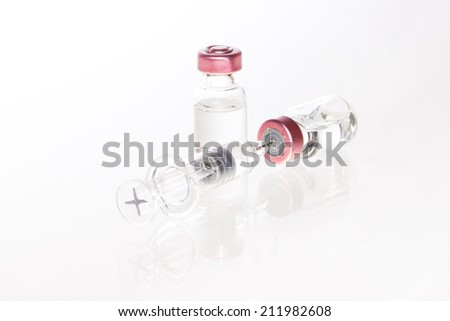 Glass Medicine Vials and botox, hualuronic, collagen or flu Syringe on a white background. - stock photo