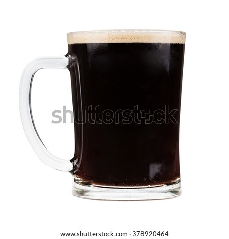 Glass mug filled with dark stout beer - stock photo