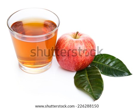Glass of apple juice with apples on a white background