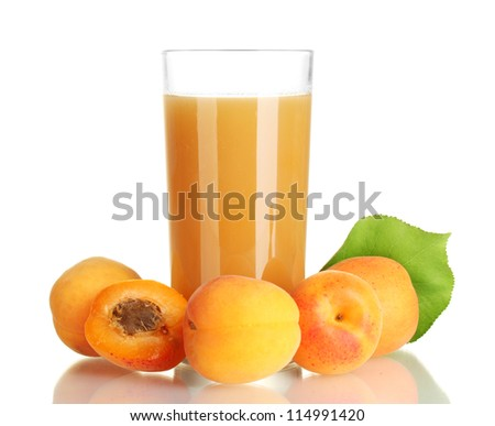 glass of apricot juice and apricots with leaves isolated on white - stock photo