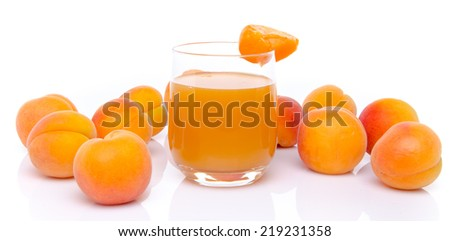 Glass of apricot juice surrounded with apricots, isolated on white - stock photo