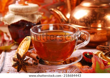 glass of autumn tea with orange ,spices and honey