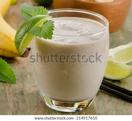 Glass of   Banana smoothie with lime . Selective focus