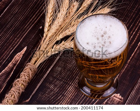 Glass of beer and ears - stock photo
