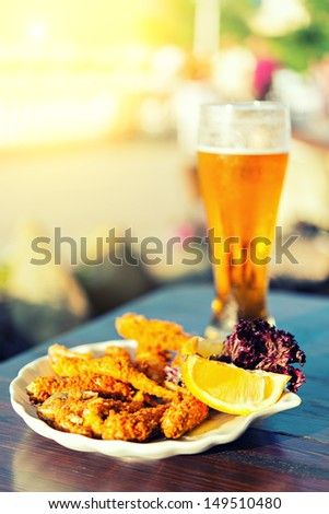 glass of beer and fish - stock photo