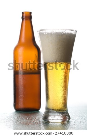 Glass of beer and the open bottle of beer on a white background - stock photo