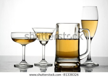 Glass of beer close-up on white background. - stock photo