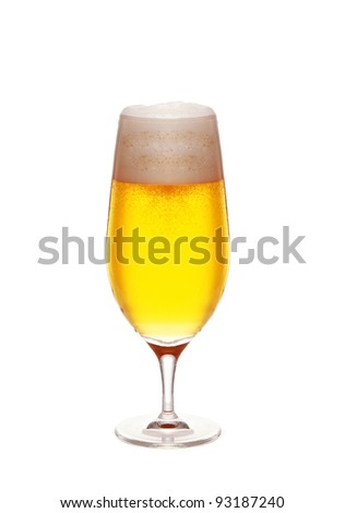 Glass of beer close-up with froth on white