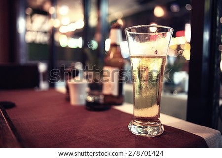glass of beer in a restaurant - stock photo