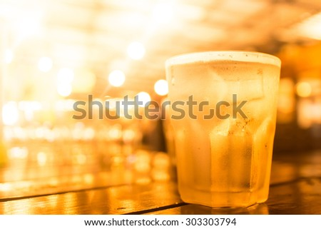 glass of beer in bar beer - stock photo