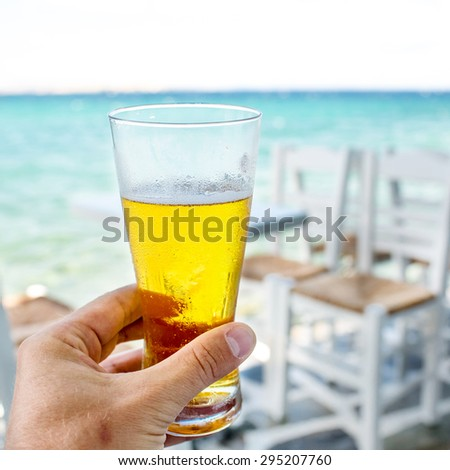 glass of beer in his hand - stock photo