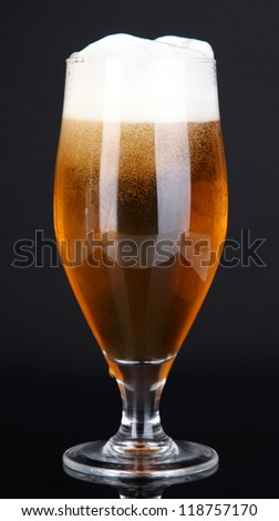 Glass of beer isolated on black - stock photo