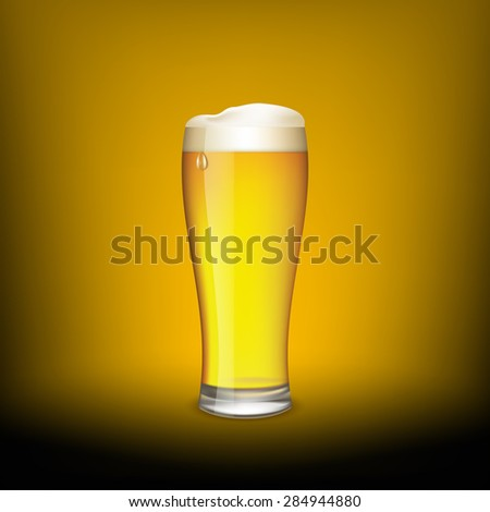 Glass of beer on a dark background.