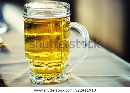 Glass of beer on a pub - stock photo