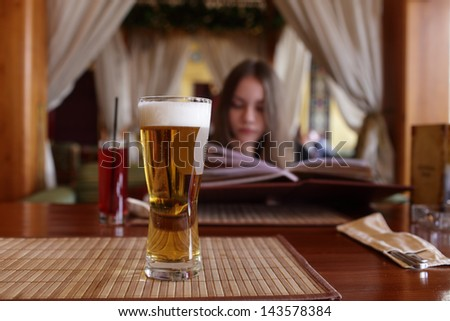 Glass of beer on a table in the restaurant - stock photo