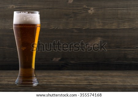 Glass of beer on a wooden countertop