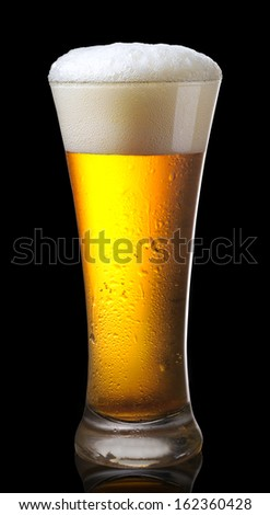 Glass of beer on black background - stock photo