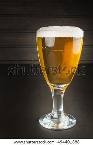 glass of beer on dark background. mug of beer on dark background.