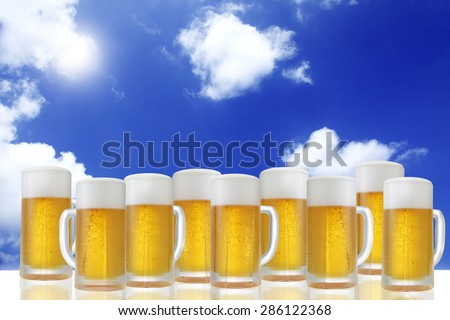Glass of beer on the background of blue sky