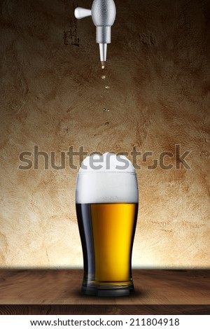 Glass of beer on wood table with grunge background