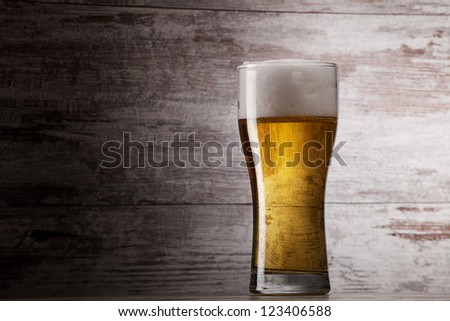 glass of beer over grunge background - stock photo