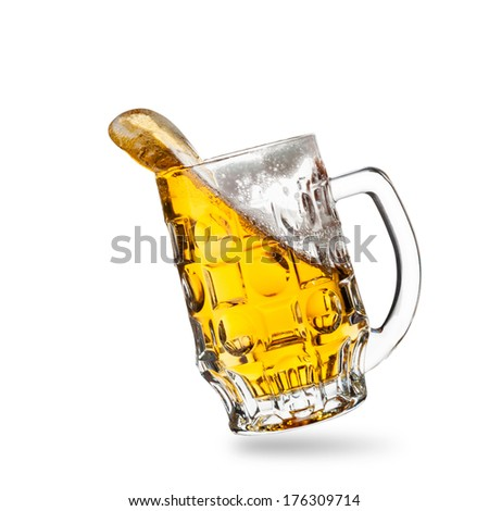 Glass of beer with a splash isolated