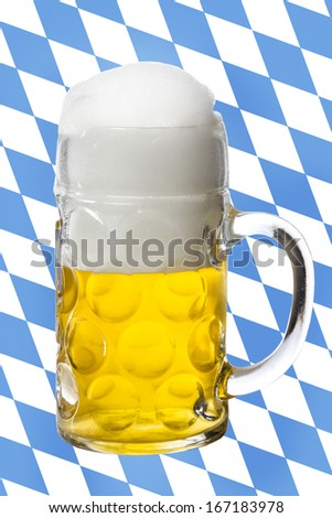 Glass of beer with bavarian flag as Background - stock photo