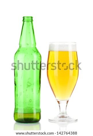 Glass of beer with bottle isolated on white - stock photo