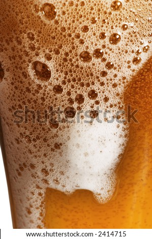Glass of beer with foam - stock photo