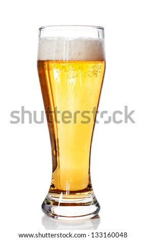 Glass of beer with foam isolated on a white background - stock photo