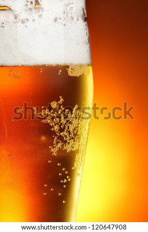 Glass of beer with froth close-up